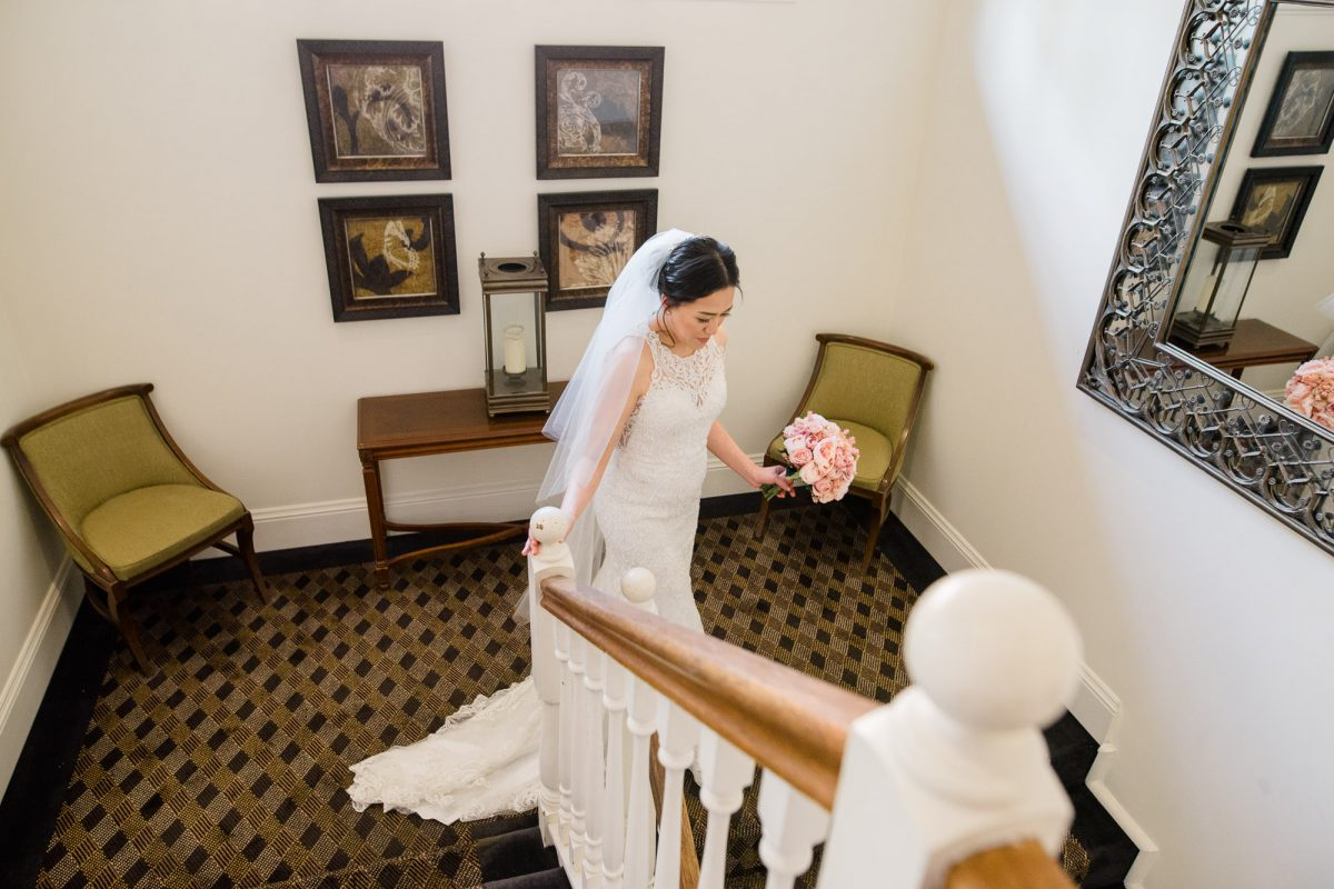 Hills-Lodge-Wedding-Bride-coming-down-the-stairs